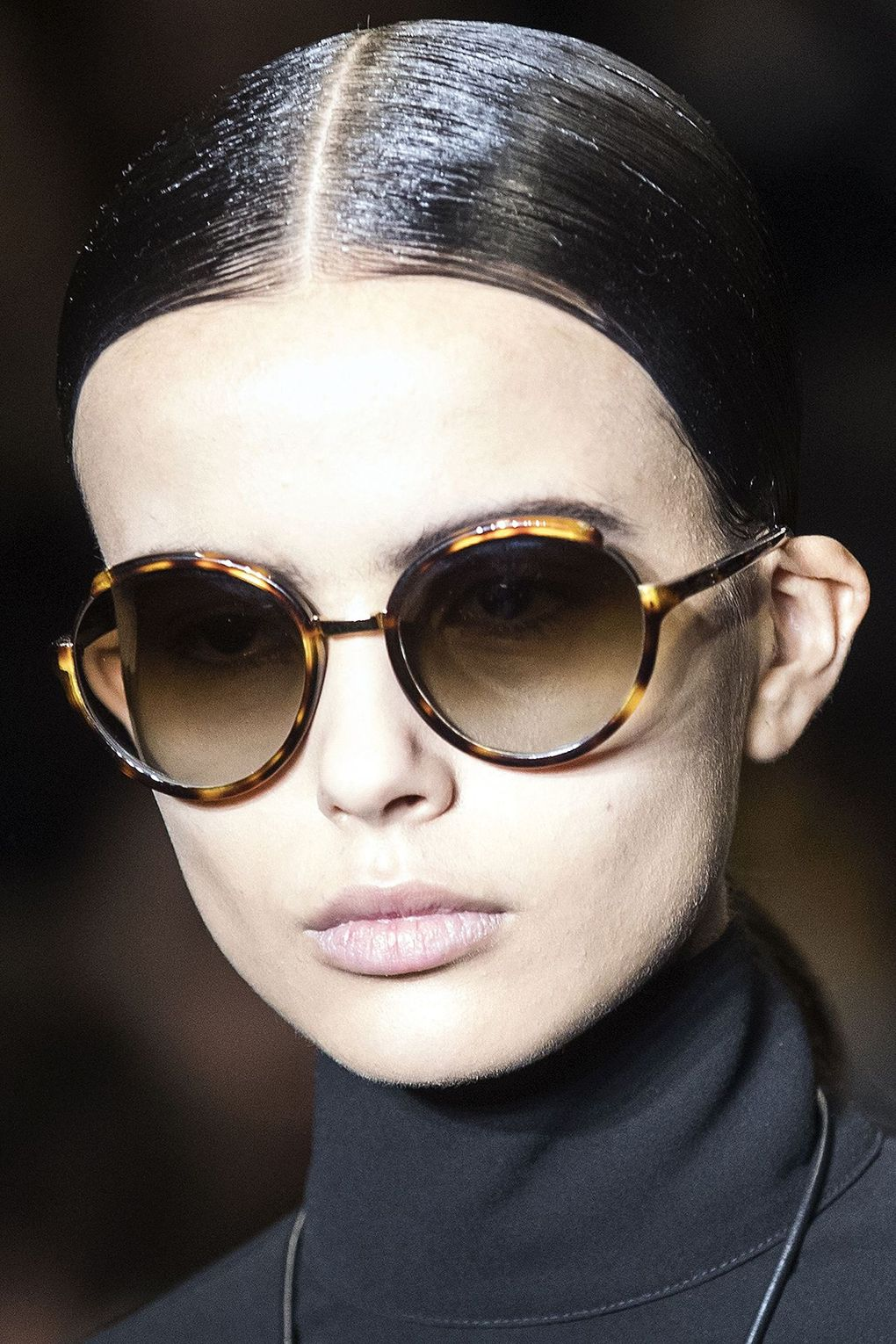 The City: Paris The Show: Loewe The Look: Slicked-back hair and centre partings
